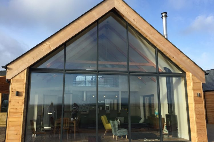 Residential domestic home with large living room window and decking - Residential Architects in Cornwall, Truro